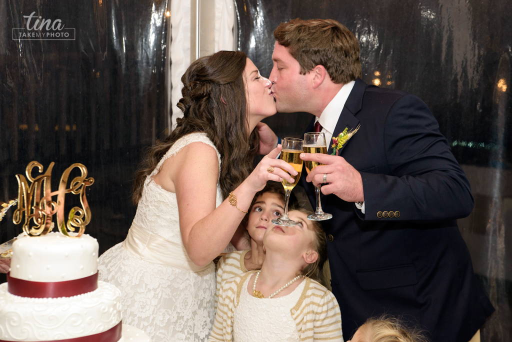 cake-kiss-cute-maroon-Richmond-virginia-wedding-photographer-tina-take-my-photo-fall-celebrations-reservoir-midlothian