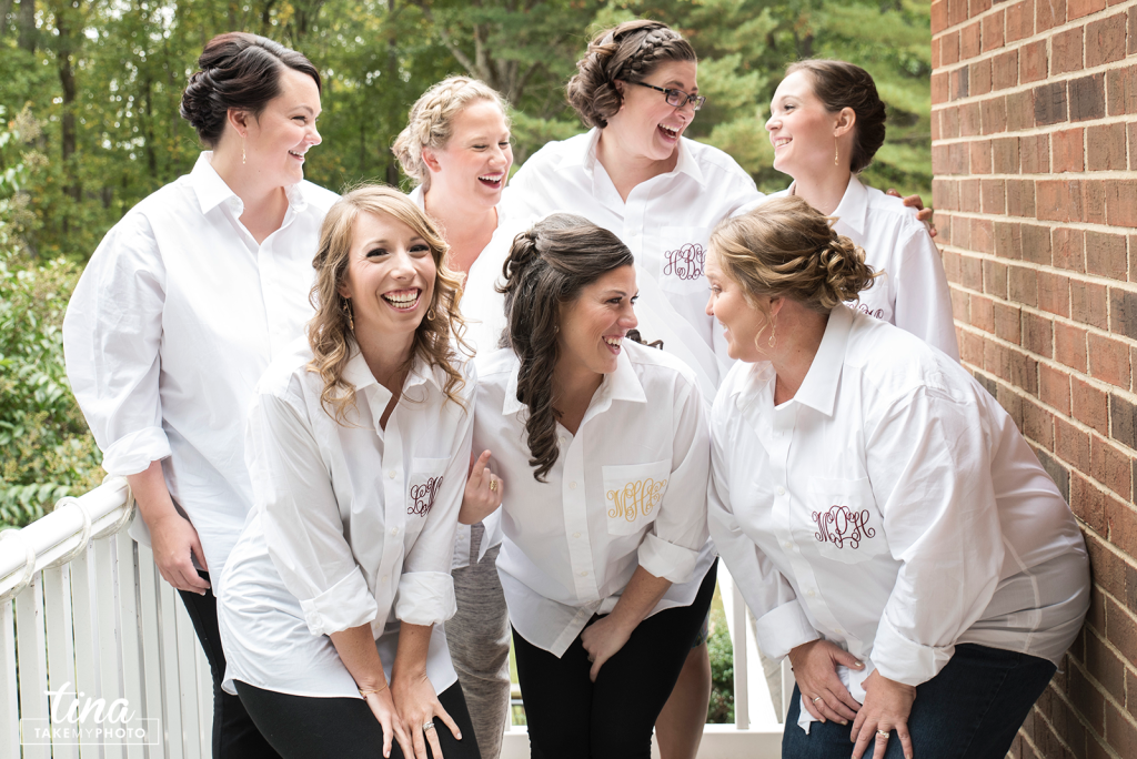 getting-ready-bridesmaids-monogrammed-shirts-collared-girlfriends-laughing-fun-happy-girls-bride-Richmond-virginia-wedding-photographer-tina-take-my-photo-fall-celebrations-reservoir-midlothian