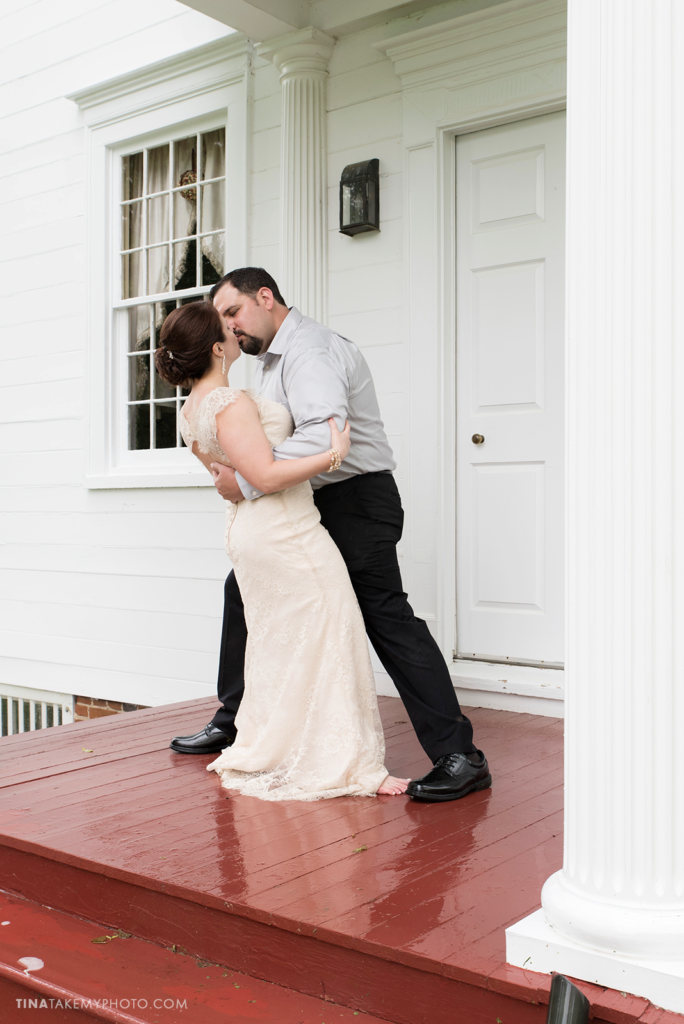 ridge-maryland-md-rainy-spring-wedding-photographer-winery-slack-woodlawn-manor-house-red-white-porch-bride-groom-portraits-dip-kiss-outdoor-spring-romantic-0708