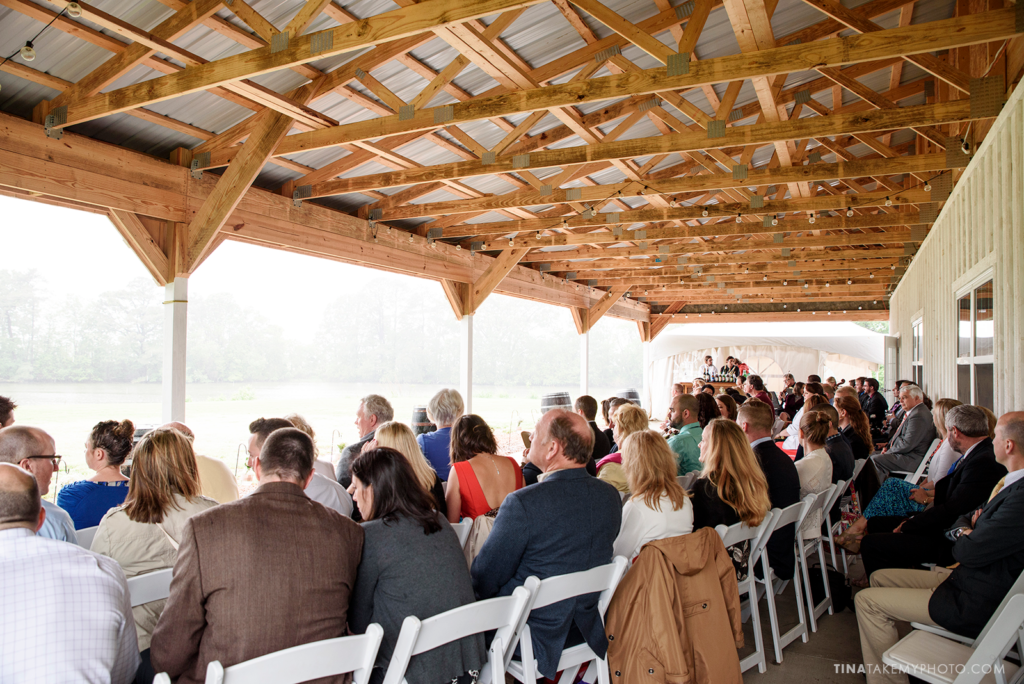 ridge-maryland-md-wedding-photographer-winery-slack-woodlawn-spring-cozy-cottage-romantic-rustic-waterfront-lake-barn-wooden-beams-ceremony-site-guests-seating-raintrt_1040